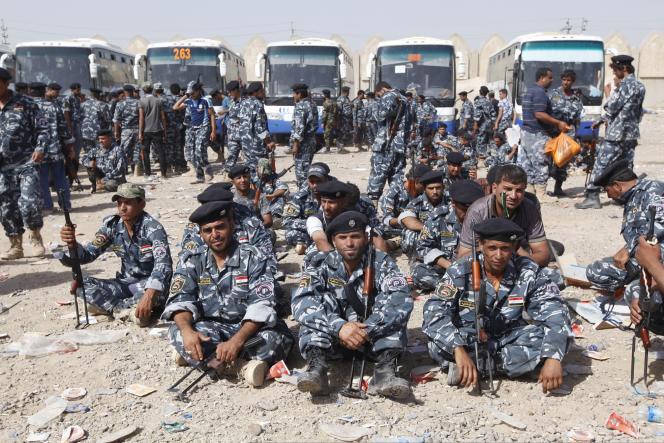 Des volontaires chiites rassemblés à Bagdad, le 18 juin.