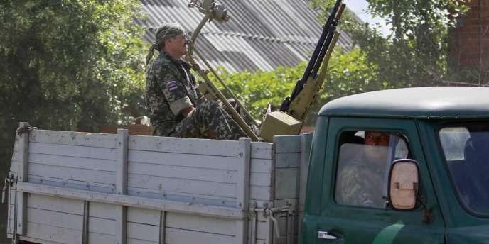 Des séparatistes prorusses non loin de Krasny-Liman (Ukraine), le 19 juin.