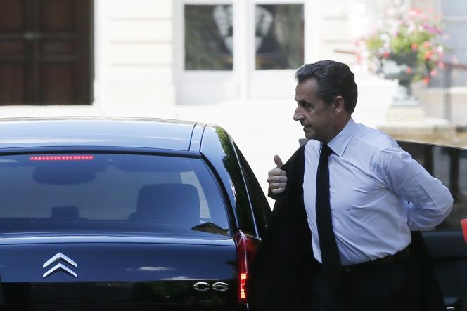 Nicolas Sarkozy arrivant à l'Assemblée nationale le 25 juin.