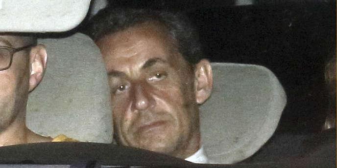 Nicolas Sarkozy, lors de son arrivée au pôle financier où il a été mis en examen par les juges d'instruction, mercredi 2 juillet.