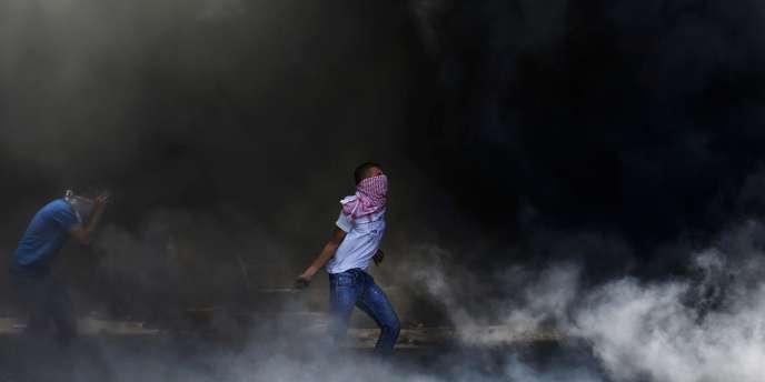 Lors d'affrontements avec la police israélienne dans Shuafat, une banlieue arabe de Jérusalem le 2 juillet, à la suite de la découverte du corps d'un jeune Palestinien. Ce meurtre pourrait être une réponse à celui des trois adolescents Israéliens enlevés en Cisjordanie.