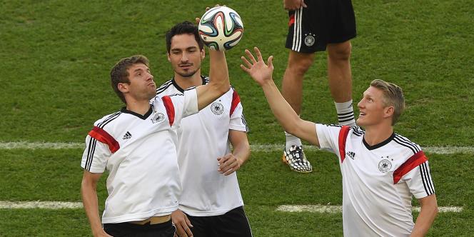 Müller, Hummels et Schweinsteiger à l'entraînement, le 3 juillet, au Maracana de Rio.