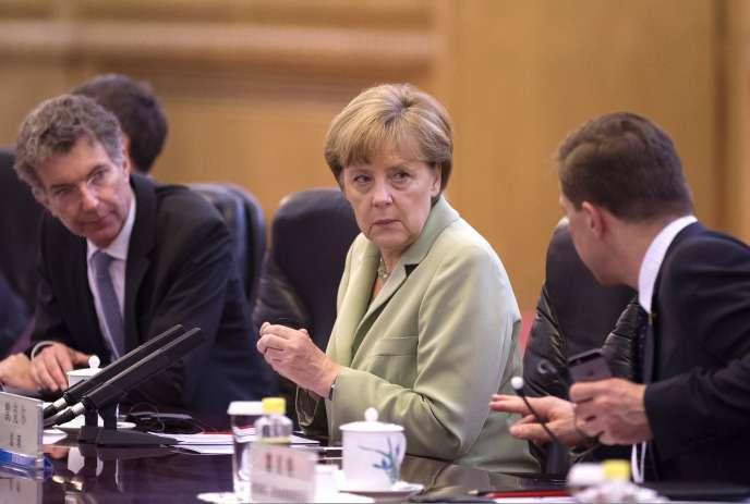 « Si c'est confirmé, il s'agirait d'une affaire très grave », a réagi, dimanche 6 juillet 2014, à l'arrestation d'un agent double allemand, la chancelière Angela Merkel, en visite officielle en Chine.