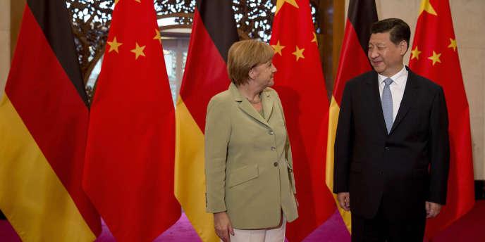 La chancelière allemande, Angela Merkel, et le président chinois, Xi Jinping, le 7 juillet à Pékin.