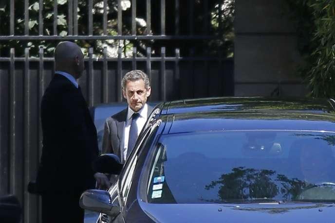Nicolas Sarkozy quitte son domicile parisien, le 2 juillet.