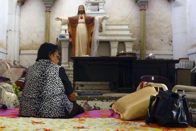 Une chrétienne de Mossoul, en Irak, réfugiée dans l'église chaldéenne du Sacré-Coeur de Jésus à Tel Kepe, dimanche 20 juillet 2014.