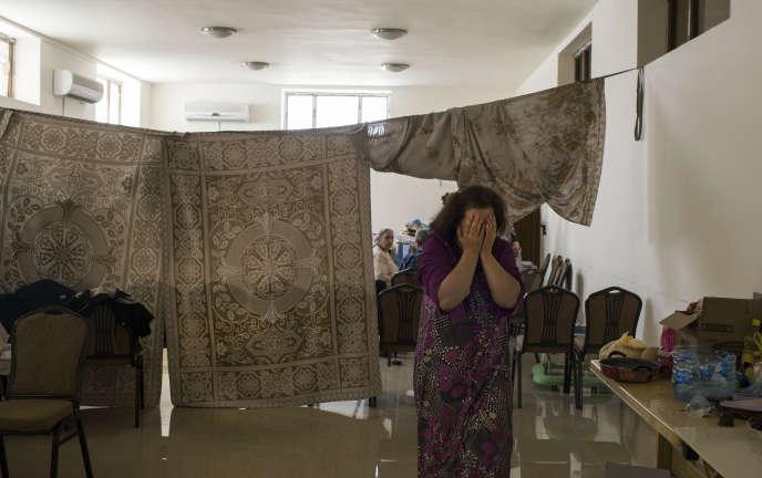 Une famille chrétienne ayant fui Mossoul s'est réfugiée dans le sous-sol d'une église d'Erbil. Ici, le 22 juillet.