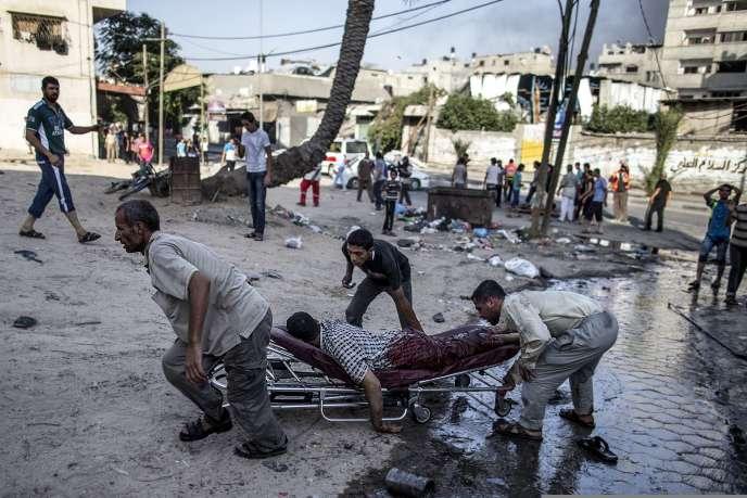 Un bombardement israélien a visé un marché, mercredi 30 juillet dans une banlieue de la ville de Gaza.