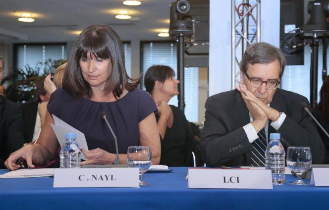 La directrice générale adjointe à l'information du groupe TF1 Catherine Nayl et et le directeur du groupe Nonce Paolini lors de leur audition public par le CSA le 7 mai, à Paris.