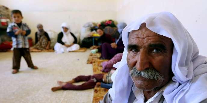 Une famille yazidie en Irak, le 5 août 2014.