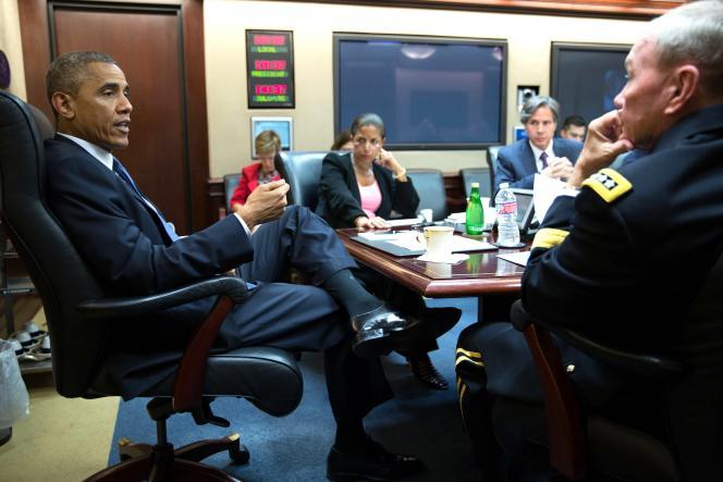 Le président Barack Obama s'entretient avec les membres du Conseil de sécurité nationale, jeudi 7 août, à la Maison Blanche.