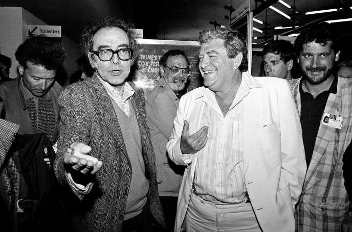 Le producteur Menahem Golan (à droite) et le réalisateur Jean-Luc Godard en 1987 à Cannes, lors de la présentation de
