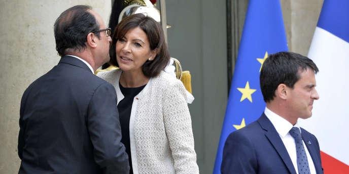 François Hollande, Anne Hidalgo et Manuel Valls, à l'Elysée, le 22 juillet.