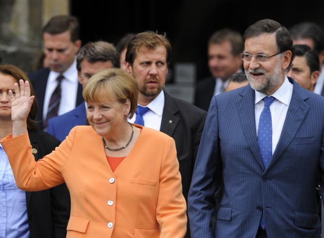 La chancelière allemande Angela Merkel et le premier ministre espagnol Mariano Rajoy à Saint-Jacques-de-Compostelle, lundi 25 août.