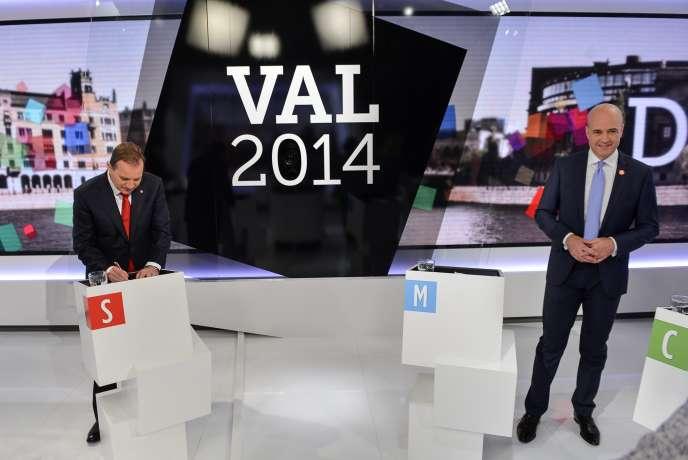 Le chef de l'opposition, le social-démocrate Stefan Löfven (à gauche), et le premier ministre, Fredrik Reinfeldt, lors d'un débat télévisé, le 11 septembre à Stockholm.