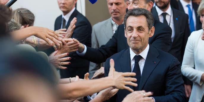 Nicolas Sarkozy, le 8 juillet 2013, à sa sortie du siège de l'UMP à Paris.