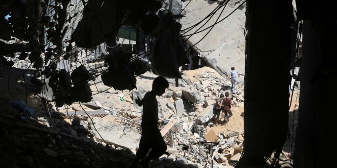 Un enfant joue dans les décombres d'une mosquée de Gaza, le19septembre2014.