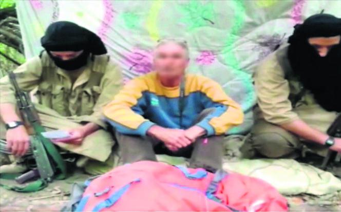 Capture d'écran de la vidéo montrant l'otage français Hervé Gourdel aux mains de ses ravisseurs.