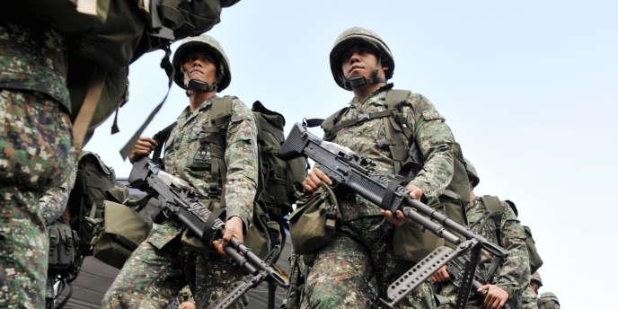 Un contingent de la marine philippine en partance vers la Sud du pays pour combattre les rebelles du groupe islamiste Abou Sayyaf en 2009.