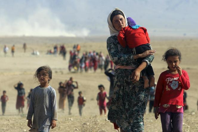 Des yézidis fuyant l'Etat islamique, le 11 août.