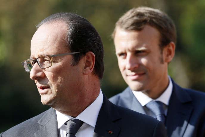 François Hollande et Emmanuel Macron dans les jardins du palais de l'Elysée, le 9 septembre 2014.