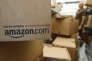 In this Oct. 18, 2010 photo, an Amazon.com package sits in a UPS truck in Palo Alto, Calif. As of 2014, the company is the biggest online retailer in the U.S., commanding about 20 percent of all e-commerce. (AP Photo/Paul Sakuma, File)