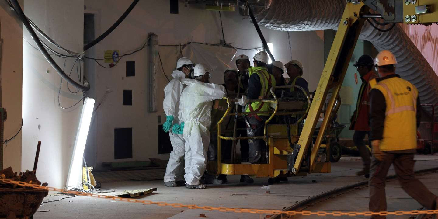 Workers are seen at the construction site of the European Pressurised Reactor project (EPR) in Flamanville, northwestern France on November 6, 2014. The construction of the EPR nuclear reactor, built by Areva and due to be operated by French energy group EDF, encountered new