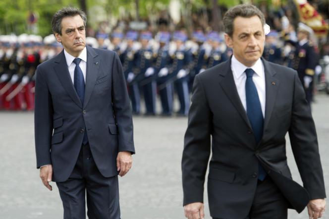 François Fillon et Nicolas Sarkozy lors de la cérémonie du 8-Mai, à l'Arc de Triomphe, en 2012.