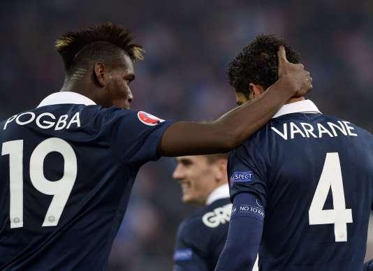 Paul Pogba et Raphaël Varane, en novembre 2014.