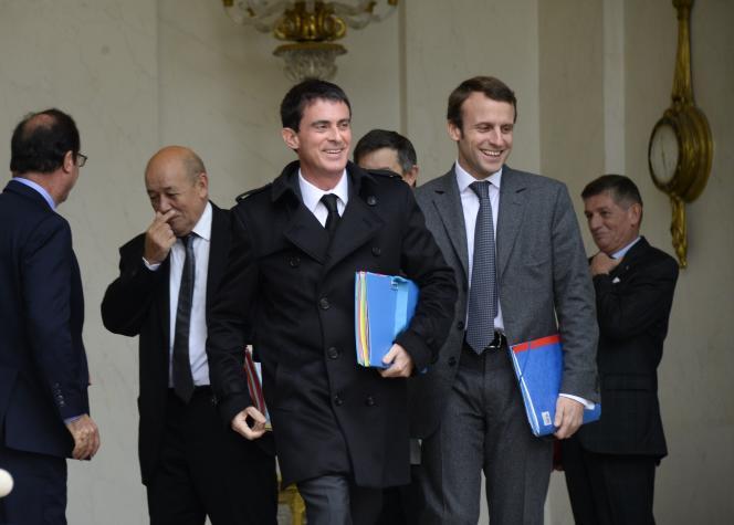 Manuel Valls et Emmanuel Macron quitte l'Elysée après le conseil des ministres, le 20 novembre.