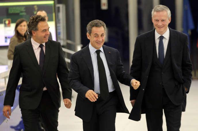 Nicolas Sarkozy, entouré de Luc Chatel et Bruno Le Maire, lundi 1er décembre