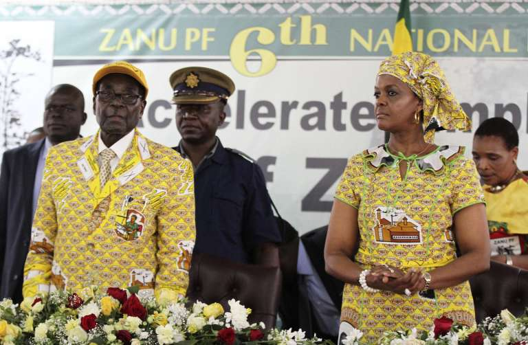"Zimbabwe President Robert Mugabe (L) and his wife Grace arrive to officially open the ruling party ZANU-PF's ongoing elective congress in Harare, December 4, 2014. Ninety-year-old Zimbabwe president Mugabe purged the deputy seen just months ago as his most likely successor, denouncing her before party loyalists as leader of a ""treacherous cabal"" bent on removing him from power.In a thunderous speech to 12,000 cadres of his ZANU-PF party, Mugabe threatened to turn the law on Vice President Joice Mujuru, whose status as presumed successor for Africa's oldest head of state has evaporated in the past three months since she became the target of attacks in state media.   REUTERS/Philimon Bulawayo (ZIMBABWE - Tags: POLITICS ELECTIONS)"
