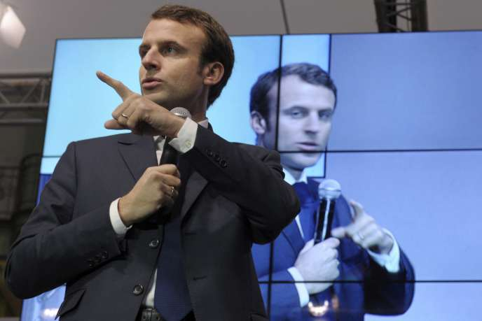 French Economy Minister Emmmanuel Macron delivers a speech during  the first