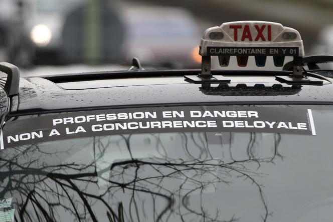 Un chauffeur de taxi participant en décembre dernier au mouvement de grève contre le service Uber accusé de concurrence déloyale.