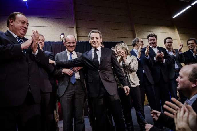 Nicolas Sarkozy et, à sa droite, Daniel Fasquelle, le trésorier de l'UMP, à Lambersart (Nord), le 25septembre.