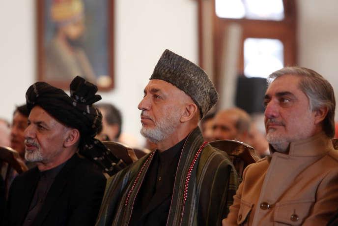 De gauche àdroite, le président afghan, Ashraf Ghani, l'ex-président Hamid Karzaï et  le  chef de l'exécutif, Abdullah Abdullah, le 1er janvier à Kaboul.
