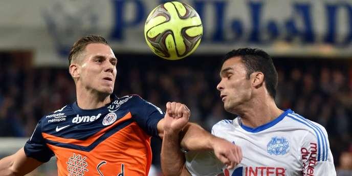 L'Héraultais Kevin Berigaud face au défenseur phocéen Jérémy Morel, vendredi 9 janvier au stade de La Mosson.
