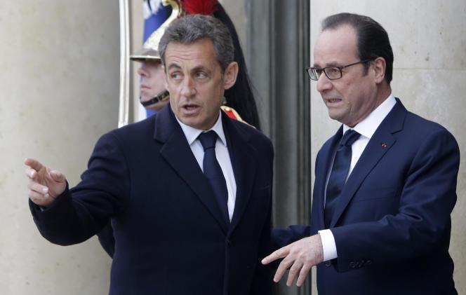Nicolas Sarkozy et François Hollande à l'Elysée, le 11 janvier.