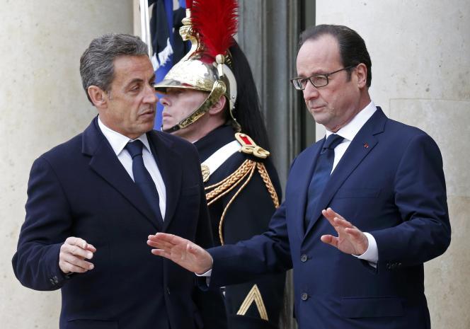 François Hollande et Nicolas Sarkozy, le 11 janvier à l'Elysée.