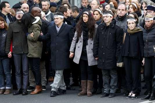 """L'équipe de """"Charlie Hebdo"""" lors de la marche républicaine, le 11 janvier 2014."""