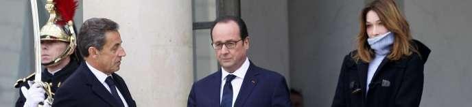 Nicolas Sarkozy, François Hollande et Carla Bruni, à l'Elysée le 11 janvier.