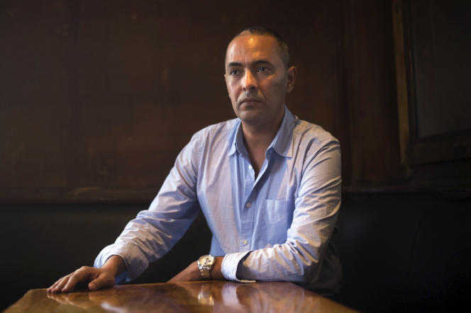 Algerian writer and journalist Kamel Daoud poses as part of a meeting with a journalist in Marseille, southern France, on October 27, 2014. Daoud received the Francois Mauriac literary award for his book