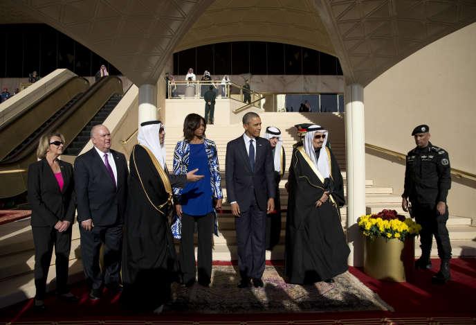 Barack et Michelle Obama, à leur arrivée à Riyad, mardi 27 janvier.