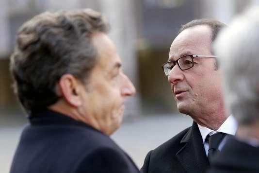 François Hollande et Nicolas Sarkozy à Paris, le 3 février 2015.