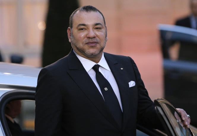 Morocco's King Mohammed VI poses as he leaves after a meeting with France's President Francois Hollande at the Elysee Palace, in Paris, France, Monday, Feb. 9, 2015.