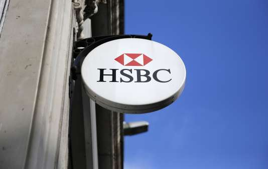 An HSBC sign is seen outside a bank branch in London February 9, 2015. British bank HSBC Holdings Plc admitted on February 8, 2015 failings by its Swiss subsidiary, in response to media reports it helped wealthy customers dodge taxes and conceal millions of dollars of assets. REUTERS/Suzanne Plunkett (BRITAIN - Tags: BUSINESS POLITICS)