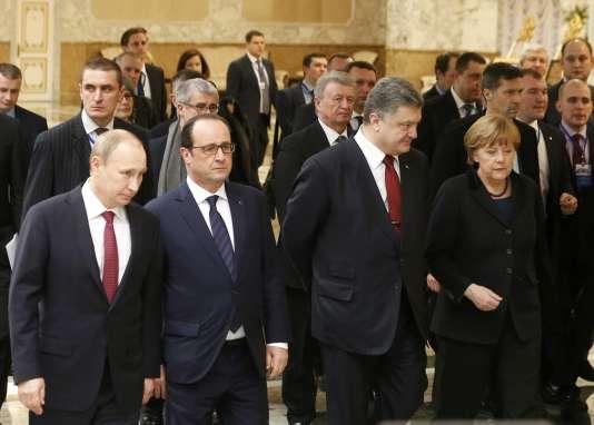 Vladimir Poutine, François Hollande,Petro Porochenko et Angela Merkel, lors de pourparlers sur la crise ukrainienne à Minsk, le 11 février 2015.