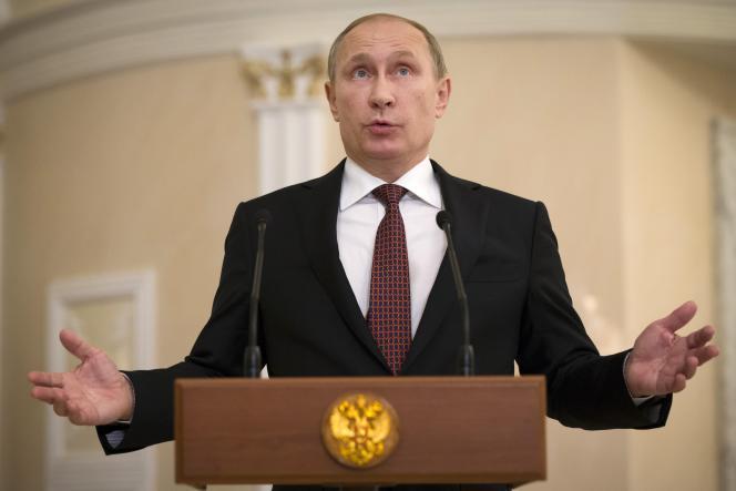 Le président russe Vladimir Poutine s'adresse aux médias à Minsk après être parvenu à un accord sur l'Ukraine jeudi 12 février.