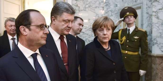 François Hollande, Petro Porochenko et Angela Merkel à Minsk, le 11 février.