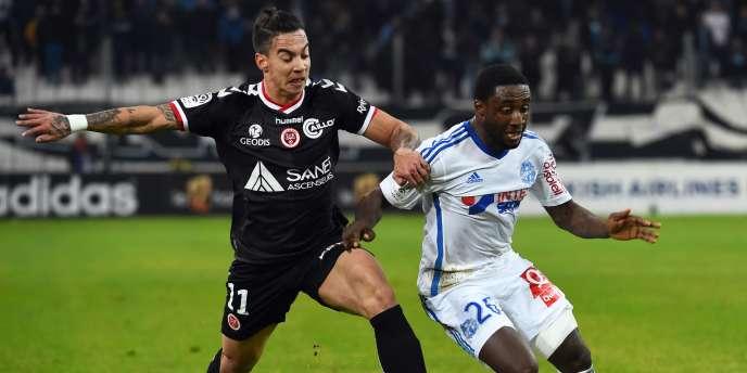 Diego Rigonato et Brice Dja Djedje lors du match de Ligue 1 entre Marseille et Reims, le 13 février 2015.
